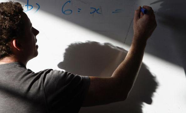 BIRMINGHAM, UNITED KINGDOM - OCTOBER 04:  A maths teacher uses his white board to explain a sum to pupils King Edward VI High School for Girls  on 4 October, 2006, Birmingham, England. The independent school for girls continues it's tradition  to be one of the top schools in Britain having achieved a 94% pass rate at A and B grades in it's A level results. Last year, 27.1% of pupils in independent schools gained three or more grade A's at A-level, compared with 8% of pupils in all state schools.  (Photo by Christopher Furlong/Getty Images)